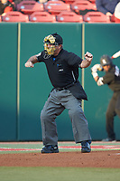 Home plate umpire Greg Howards makes a strike call during the game between the North Carolina State Wolfpack and the Louisville Cardinals at Doak Field at Dail Park on March 24, 2017 in Raleigh, North Carolina. The Wolfpack defeated the Cardinals 3-1. (Brian Westerholt/Four Seam Images)