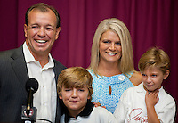 TALLAHASSEE, FLA. 8/4/11-FISHER080511 CH-Florida State University Head Football Coach Jimbo Fisher, left, and wife Candi are joined by sons Trey, 10, and Ethan, 6, right, at the start of a news conference Friday where they talked about Fanconi anemia, a rare blood disorder Ethan was diagnosed with earlier this year. While Ethan is healthy now, doctors anticipate he will need a bone marrow transplant in the future to combat the disease. The Fishers announced the creation of the Kidz 1st Fund to raise money to fund research to find a cure for the disease..COLIN HACKLEY PHOTO