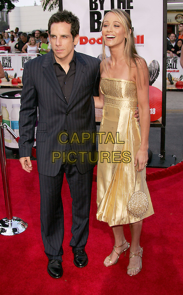 "BEN STILLER & CHRISTINE TAYLOR.The World Premiere of ""Dodgeball:A True Underdog Story"", Westwood, California.June 14th, 2004.full length, full-length, black pinstripe suit, gold strapless, silk, satin dress, gold bag, purse.www.capitalpictures.com.sales@capitalpictures.com.©Capital Pictures"