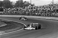 BOWMANVILLE, ONTARIO - OCTOBER 3: James Hunt of Great Britain drives his McLaren M23 8-2/Ford Cosworth ahead of Larry Perkins of Australia in the Brabham BT45 3/Alfa Romeo 115-12 during the Canadian Grand Prix FIA Formula 1 race at Mosport Park near Bowmanville, Ontario, on October 3, 1976.