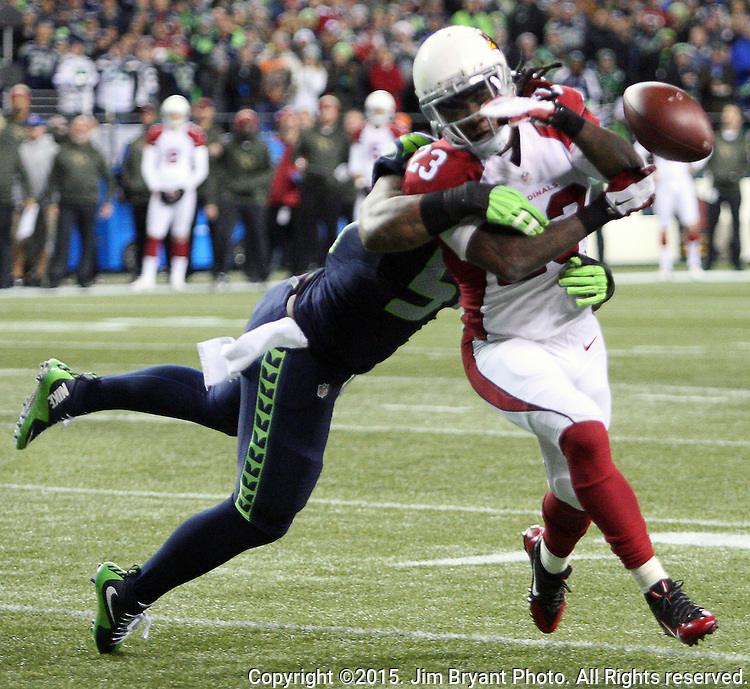 Seattle Seahawks linebacker Bruce Irvin (51) knocks the ball away from Arizona Cardinals running back Chris Johnson (23) at CenturyLink Field in Seattle, Washington on November 15, 2015. The Cardinals beat the Seahawks 39-32.   ©2015. Jim Bryant photo. All Rights Reserved.