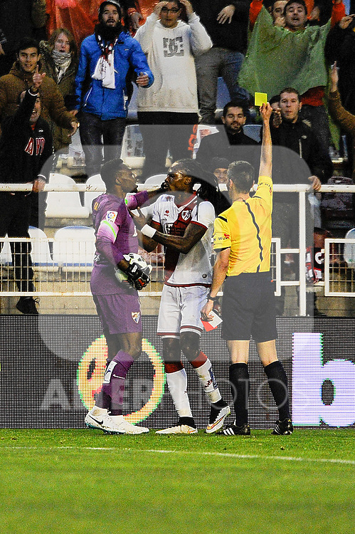 Rayo Vallecano´s Manucho and Malaga CF´s goalkeeper Idriss Carlos Kameni discuss while the referee Santiago Jaime Garcia shows a Yellow card to Manucho during 2014-15 La Liga match between Rayo Vallecano and Malaga CF at Rayo Vallecano stadium in Madrid, Spain. March 21, 2015. (ALTERPHOTOS/Luis Fernandez)