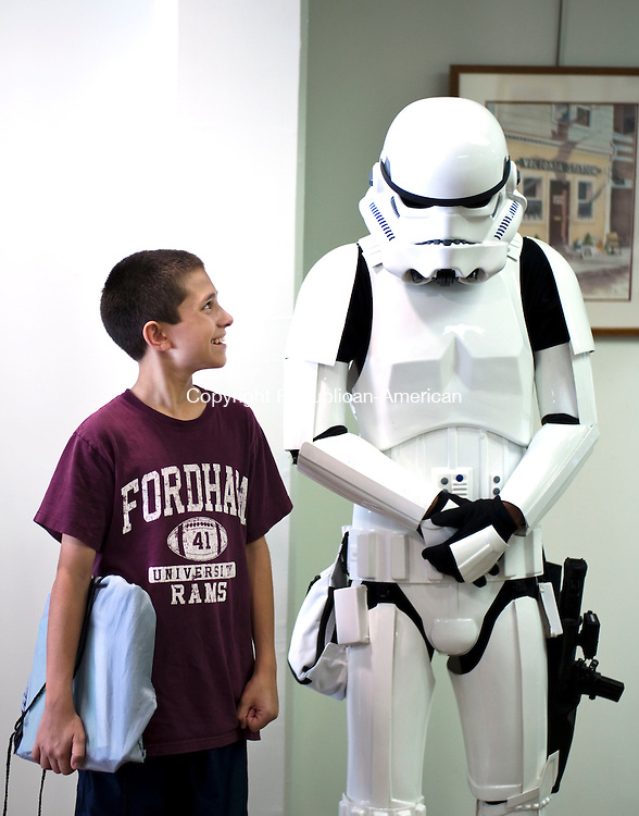 Middlebury, CT- 04 August 2016-080416CM06-  Cayman Chacchia 12, of Woodbury meets with Ben Beneacileo of Middlebury, who is dressed as a Storm Trooper at the Middlebury Public Library on Thursday.  The event was part of the summer reading program, which ended with a showing of Star Wars: The Force Awakens.      Christopher Massa Republican-American