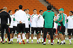 10 JUN 2010: Head coach Javier Aguirre (in green at right) talks to the team. The Mexico National Team held a light practice at Soccer City Stadium in Johannesburg, South Africa the day before playing South Africa in the opening match of the 2010 FIFA World Cup.