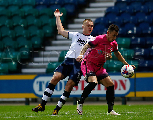 09.08.2016. Deepdale, Preston, England. Football League Cup 1st Round. Preston North End versus Hartlepool. Hartlepool United midfielder Nathan Thomas holds off the challenge of Preston North End midfielder Liam Grimshaw.
