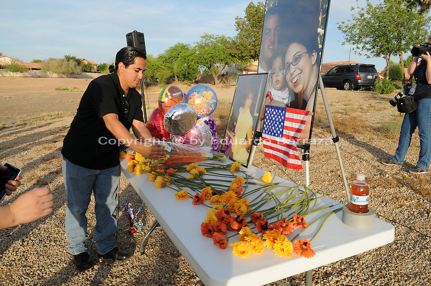 "Gilbert, Arizona – Friends and family of the Mederos Family gathered to hold a memorial for the four victims of the Gilbert Massacre occurred on May 2, 2012. According to Gilbert Police, Lisa Mederos, Amber Mederos, baby Lilly Mederos, and Jim Hiott (Amber's fiancé) were all killed by notorious white supremacist and Neo-Nazi Jason ""J.T."" Ready before taking his own life. In this image, a high-school friend of victim Amber Mederos pays his respects by bringing flowers to the memorial. Amber's friend did not want to provide his name, but said they attended together Mesquite High School, in Gilbert, where the massacre occurred.. Photo by Eduardo Barraza © 2012"