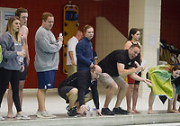NWA Democrat-Gazette/CHARLIE KAIJO Coaches cheer on their swimmers during a swim meet, Saturday, February 9, 2019 at the University of Arkansas HYPER pool in Fayetteville.