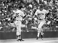 Dwight Evans of the Boston Red Sox is greeted by third base coach Joe Morgan during a 1988 season game at Anaheim Stadium,in Anaheim,California.(Larry Goren/Four Seam Images)