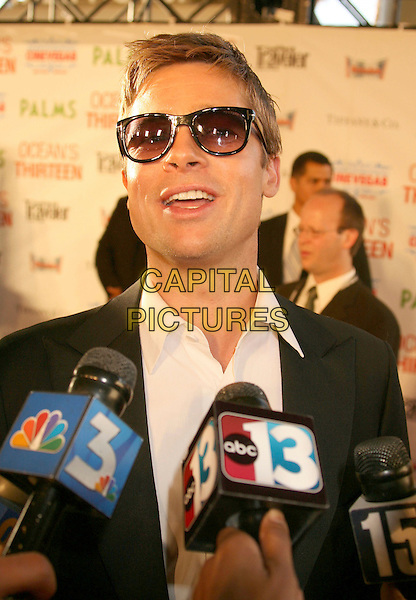 "BRAD PITT.2007 CineVegas Film Festival ""Ocean's 13"" Premiere held at Palms Casino Resort, Las Vegas, Nevada, USA..June 6th, 2007.headshot portrait sunglasses shades microphones interview mouth open .CAP/ADM/RE.©Russ Elliot/AdMedia/Capital Pictures"
