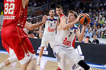 Real Madrid's Luka Doncic and Crvena Zvezda Mts Belgrade's Ognjen Kuzmic during Turkish Airlines Euroleague match between Real Madrid and Crvena Zvezda Mts Belgrade at Wizink Center in Madrid, Spain. March 10, 2017. (ALTERPHOTOS/BorjaB.Hojas)