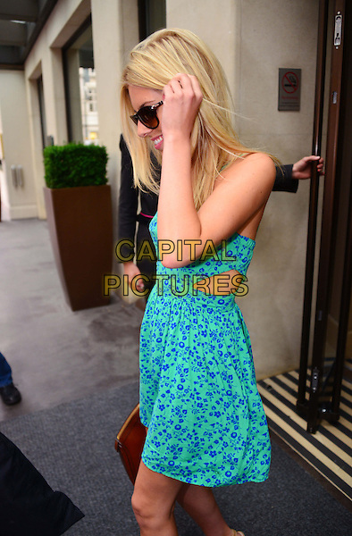 Mollie King of The Saturdays<br /> Spotted leaving The Mayfair Hotel, London, England.<br /> August 13th, 2013<br /> half length blue green floral print dress side profile sunglasses shades hand arm cut out away side<br /> CAP/BF<br /> &copy;Bob Fidgeon/Capital Pictures