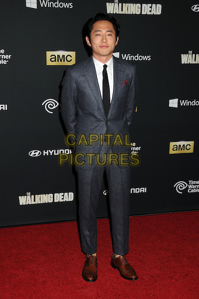 Steven Yeun<br /> &quot;The Walking Dead&quot; 4th Season Premiere held at the AMC Universal Citywalk Stadium 19 Theatre, Universal City, California, USA, <br /> 3rd October 2013.<br /> full length grey gray suit tie <br /> CAP/ADM/BP<br /> &copy;Byron Purvis/AdMedia/Capital Pictures
