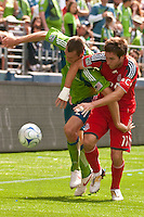 Nate Jaqua (L) of the Seattle Sounders struggles with Jim Brennan (11) of Toronto FC in the match at the XBox Pitch at Quest Field on August 29, 2009. The Sounders and Toronto played to a 0-0 draw.