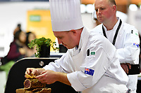 Melbourne, 30 May 2017 - Michael Cole of the Georgie Bass Cafe & Cookery in Flinders plates up his meat platter at the Australian selection trials of the Bocuse d'Or culinary competition held during the Food Service Australia show at the Royal Exhibition Building in Melbourne, Australia. Photo Sydney Low