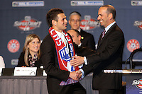 1st Round 5th draft pick Peri Marosevic chosen by FC Dallas shking hands with MLS Commissioner Don Garber at the MLS Super Draft 2009.