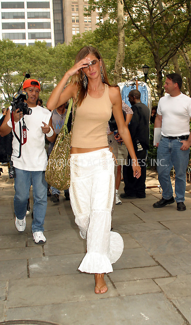 Supermodel Gisele Bundchen takes a lot of heat from photographers as she departs Bryant Park during New York Fashion Week. New York, September 18, 2002. Please byline: Alecsey Boldeskul/NY Photo Press.   ..*PAY-PER-USE*      ....NY Photo Press:  ..phone (646) 267-6913;   ..e-mail: info@nyphotopress.com....Giselle