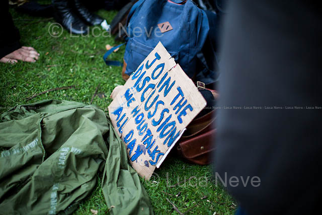 Day VII - 23.10.2014 <br /> <br /> London 17-26.10.2014. A day at the Parliament Square Occupy Democracy Camp in London. Protesters have been camping in Parliament Square since the 17th of October and they will leave on Sunday the 26th. Since the beginning of the direct action protesters have been battling with the MET Police and the Greater London Authority's Heritage Wardens (provided under private contract by AOS Security) over the specific bylaw which applies to a designated area immediately surrounding and including Parliament Square and which bans sleeping equipment. Several people have been arrested, including the Green Party's Baroness Jenny Jones, member of the London Assembly who was later &quot;de-arrested&quot;. In the meantime, numerous celebrities, politicians, experts, activists, and members of the public met for conferences and debates about various topics, from democracy to climate change, to the economic crisis, to corruption, to poetry and many more.<br /> <br /> For more information please click here: http://occupydemocracy.org.uk/ &amp; http://on.fb.me/12tuv79