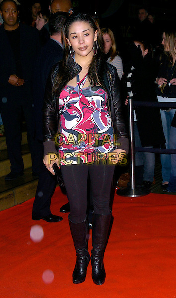 MUTYA BUENA.Arrivals - Emeralds & Ivy Ball, The Roundhouse, .London, England, December 1st 2006..full length black leather jacket knee high boots pink patterned print top leggings.CAP/CAN.©Can Nguyen/Capital Pictures