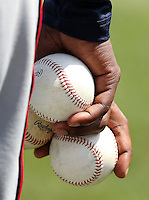 Minnesota Twins baseballs being held by a coach before a spring training game against the Pittsburgh Pirates at McKechnie Field on March 10, 2012 in Bradenton, Florida.  Minnesota defeated Pittsburgh 4-2.  (Mike Janes/Four Seam Images)