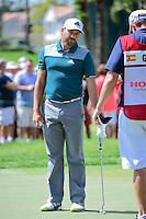 Sergio Garcia (ESP) discusses his putt on 8 with his caddie during round 1 of the Honda Classic, PGA National, Palm Beach Gardens, West Palm Beach, Florida, USA. 2/23/2017.<br /> Picture: Golffile | Ken Murray<br /> <br /> <br /> All photo usage must carry mandatory copyright credit (&copy; Golffile | Ken Murray)