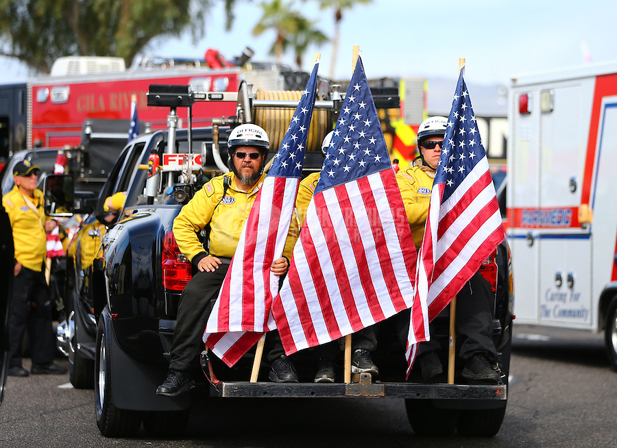Feb 26, 2017; Chandler, AZ, USA; NHRA safety safari members hold American flags during the Arizona Nationals at Wild Horse Pass Motorsports Park. Mandatory Credit: Mark J. Rebilas-USA TODAY Sports