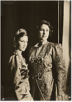 BNPS.co.uk (01202 558833)<br /> Pic: MarcusAdams/ChiswickAuctions/BNPS<br /> <br /> Princess Elizabeth and Princess Margaret dressed up as Aladdin in 1943. <br /> <br /> Charming childhood photos of Princess Elizabeth and Princess Margaret have come to light, including a previously unseen image of the future Queen in a kilt.<br /> <br /> The portraits, taken by acclaimed British society photographer Marcus Adams, capture the future Queen from being a baby to her adolescence.<br /> <br /> The Queen Mother would often take her daughters to his central London studio where he would set up toys and props to keep them entertained