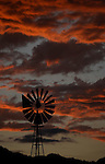 The Sierra sunset behind a windmill in Gardnerville, Nev., on Thursday, July 14, 2011..Photo by Cathleen Allison