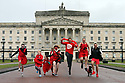 ON THE RUN AT STORMONT:Hundreds of runners and walkers in red took over Stormont today to take part in Northern Ireland's only Red Dress Run, organised by Northern Ireland Chest Heart and Stroke.  Only in its second year the event has proved hugely popular with 400 people taking part. Pictured is the charity's ambassador and rugby star Chris Henry alongside Shaun Fraser, Storm McIlveen-Fraser, Summer McIlveen-Fraser, Michelle McIlveen, Graham Ross, Conor Trainer, (Dog Ruby) and Michael Fraser. Photo/Paul McErlane