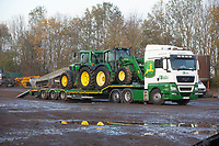 Tractors bing loaded for export out of Cambridge Machinery sales<br />
