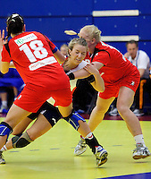 31 MAR 2010 - LONDON, GBR - Britains Nina Heglund (in white) tries to get through the Icelandic defence in the two teams 2010 European Womens Handball Championships qualifier .(PHOTO (C) NIGEL FARROW)