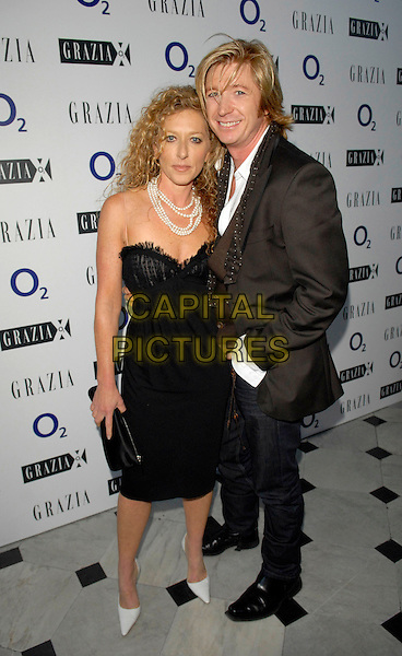 KELLY HOPPEN & NICKY CLARKE.The Grazia O2 Awards, Sunbeam Studio, London, England. .July 19th, 2007.full length black dress skinny spaghetti straps white shoes jeans denim hand in pocket pearl necklace lace brown suit jacket .CAP/FIN.©Steve Finn/Capital Pictures