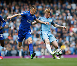 Marc Albrighton of Leicester City in action with Kevin De Bruyne of Manchester City during the English Premier League match at the Etihad Stadium, Manchester. Picture date: May 13th 2017. Pic credit should read: Simon Bellis/Sportimage