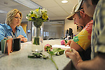 Rock Island, Illinois couple (l-r) Curtis Harris, 50, and Daren Adkisson, 39, double check their marriage license as vital records clerk Rebecca Badtram looks on first thing in the morning at the Scott County Recorder's Office the first day same sex weddings are legal across Iowa in Davenport, Iowa on April 27, 2009.