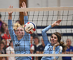 Jerseyville players Lauren Rexing (left) and Abby Manns deflected the ball back to the Marquette team. Jerseyville played at Alton Marquette in a girls volleyball game on Wednesday September 11, 2018.<br /> Tim Vizer/Special to STLhighschoolsports.com