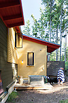 An outdoor metal bathtub offers a fun place to rinse off on a summer day. This image is available through an alternate architectural stock image agency, Collinstock located here: http://www.collinstock.com