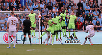 Andre Ayew of Swansea City (R) takes a free kick with which he equalised during the Swansea City FC v Manchester City Premier League game at the Liberty Stadium, Swansea, Wales, UK, Sunday 15 May 2016