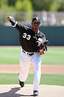 Edwin Jackson #33 of the Chicago White Sox plays in a spring training game against the Texas Rangers at Camelback Ranch on March 12, 2011 in Glendale, Arizona. .Photo by:  Bill Mitchell/Four Seam Images.