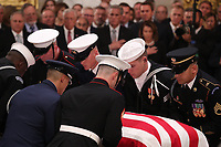 The casket of former U.S. President George H.W. Bush is delivered by a military honor guard to lie in state in the U.S. Capitol Rotunda as members of the U.S. House leadersip look on in Washington, U.S., December 3, 2018. <br /> CAP/MPI/RS<br /> &copy;RS/MPI/Capital Pictures