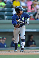 Shortstop Milton Ramos (7) of the Columbia Fireflies bats in a game against the Greenville Drive on Sunday, April 24, 2016, at Fluor Field at the West End in Greenville, South Carolina. Greenville won, 5-1. (Tom Priddy/Four Seam Images)