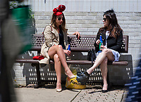 LOUISVILLE, KY - MAY 06: Two women sit on a bench and talk on Kentucky Derby Day at Churchill Downs on May 6, 2017 in Louisville, Kentucky. (Photo by Douglas DeFelice/Eclipse Sportswire/Getty Images)