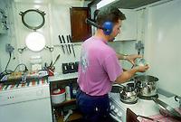 """- pusher of """"Fluviopadana"""" company with barges in navigation on the Po river, the cook in kitchen....- spintore della compagnia """"Fluviopadana"""" e chiatte in navigazione sul fiume Po, il cuoco in cucina"""