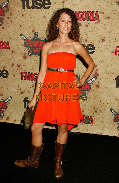 LEAH RACHEL.Fuse Fangoria Chainsaw Awards held at The Orpheum Theatre, Los Angeles, California, USA - Arrivals.October 15th, 2006.Ref: ADM/RE.full length orange strapless dress brown boots hand on hip.www.capitalpictures.com.sales@capitalpictures.com.©Russ Elliot/AdMedia/Capital Pictures.