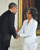 Joan Myers Brown, right, shakes hands with United States President Barack Obama, left, prior to accepting the 2012 National Medal of Arts during the presentation ceremony in the East Room of the White House in Washington, D.C. on Wednesday, July 10, 2013.<br /> Credit: Ron Sachs / CNP