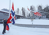 Flag being  flow at half mast at Norwegian Air Ambulance headquarters following a crash where a helicopter goes down after striking power lines. It was about to land at the site of a traffic accident. The pilot and doctor were killed, while the rescue paramedic was severely injured. <br />