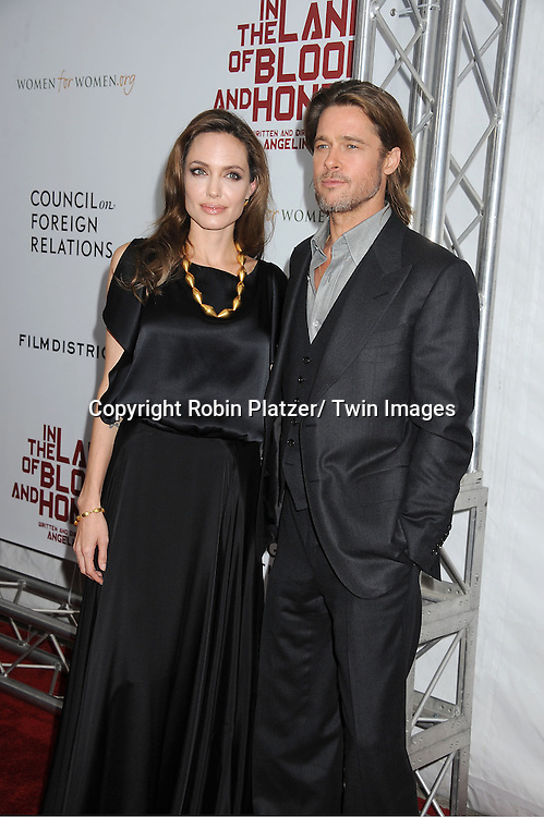 """Angelina Jolie and Brad Pitt attend The New York Premiere of Angelina Jolie's movie ."""" In the Land of Blood and Honey"""" on December 5, 2011 at The School of Visual Arts Theatre in New York City."""