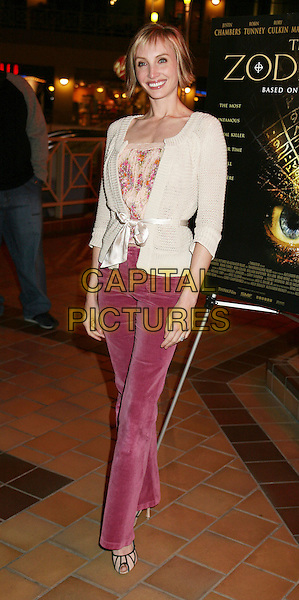 "KATELIN CHESNA.Los Angeles Premiere of ""The Zodiac"", West Hollywood, California , USA.March 13th, 2006.Photo: Byron Purvis/AdMedia/Capital Pictures.Ref: BP/ADM.full length white cardigan pink trousers.www.capitalpictures.com.sales@capitalpictures.com.© Capital Pictures."