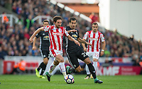 Joe Allen of Stoke City battles Henrikh Mkhitaryan of Man Utd during the Premier League match between Stoke City and Manchester United at the Britannia Stadium, Stoke-on-Trent, England on 9 September 2017. Photo by Andy Rowland.