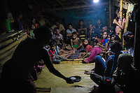 "March 25, 2016 - Wainyapu (Indonesia). Villagers gather inside the house of the ""Rato"" - the traditional priest leader - singing a traditional song to call the ""Nyale"" -  a sea worm that normally appears on the shore on Pasola day. The number of nyale collected is believed to be a sign of the richness of the farmers' next harvest season. © Thomas Cristofoletti / Ruom"