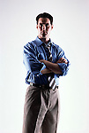 Caucasian looking man wearing a blue shirt and tie facing forward