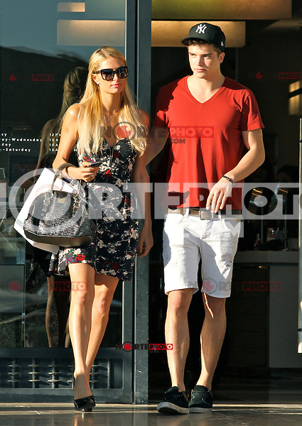 Paris Hilton &amp; Beau River Viiper. Just out of trouble with arrest for battery charges, Paris new Boy Toy River, is seen shopping here with Paris at Barney's New York. Beverly Hills, CA. October 16, 2012.<br />